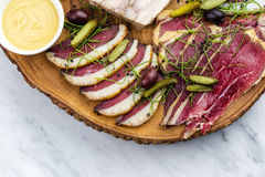Cold smoked meat plate with, proscius on white wooden desk. Royalty Free Stock Photos
