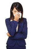 Cold sneezing asian business woman. Isolated on white background royalty free stock photography