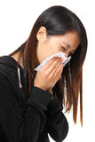 Cold sneezing asian woman Stock Photography