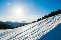 Cold snow ski slope on Alps mountain, France Royalty Free Stock Images