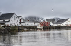 Cold Snowy Norwegian Harbour Seascape View at Toppoya and Hamnoy Bays of Lofoten Islands. Horizontal Image Orientation Stock Photos