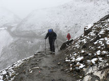 Cold snowy weather on way to Thorong La Pass, Nepal Stock Photo
