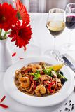 Cold Soba Buckwheat Noodle Salad, Popular Korean Dish. Cold Soba Buckwheat Noodle Salad with shrimp and grilled vegetables on white table with white wine Royalty Free Stock Photography