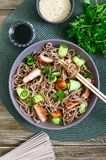 Cold soba with chicken, fresh cucumbers, sauce and sesame. Classic cold salad with buckwheat noodles. Japanese food. Traditional. Asian cuisine. Top view, flat royalty free stock photography