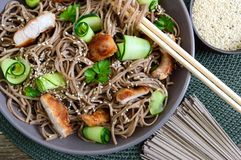 Cold soba with chicken, fresh cucumbers, sauce and sesame. Classic cold salad with buckwheat noodles. Japanese food. Traditional. Asian cuisine. Top view, flat stock images