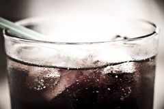 Cold Soda. Close-up of cold soda with ice cubes royalty free stock photography