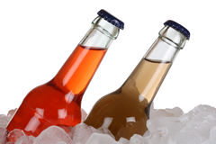 Cold soda drinks and cola on ice. Cold soda drinks and cola in bottles on ice cubes stock photo