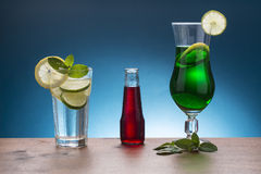 Cold soda with lemon and mint, red italian aperitif, and mint  l Stock Image