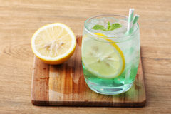 Cold soft drink from apple syrup and mint Royalty Free Stock Images