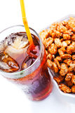 Cold soft drink and crispy peanut Royalty Free Stock Photography