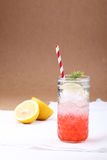 Cold soft drink from strawberry syrup and lemon with red straw Royalty Free Stock Image