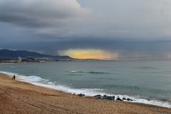 Cold, somewhat sunny morning. Cloudy morning in Badalona Stock Images