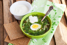 Cold sorrel soup with egg. Cold summer sorrel soup with eggs and sour cream Stock Photo