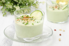 Cold soup with avocado, cucumber and yogurt in a glass beaker Stock Photography