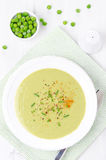 Cold soup of green peas with yogurt and chives top view Stock Photo