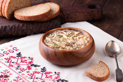 Cold Soup Okroshka in bowl and raw ingredients on wooden table royalty free stock images