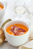 Cold soup with smoked meat in white cup Royalty Free Stock Photo