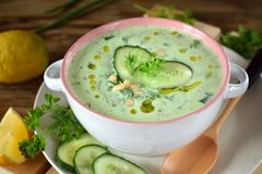 Free Cold Soup Tarator With Kefir, Cucumbers And Pine Nuts In A Ceramic Tureen Royalty Free Stock Image - 118323996