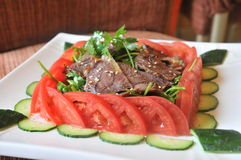 Cold spiced beef with vege and sauce royalty free stock images