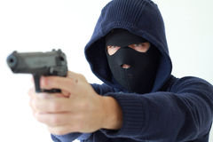 Cold stare. Of a robber pointing a gun two hand held Stock Photos