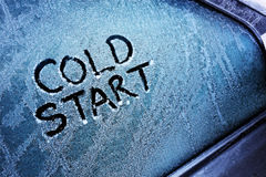 Cold start. Message written on frozen car windshield window stock photography