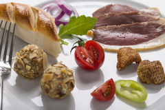 Cold starter, with smoked ham, liver bon-bon, and greaves, decor Royalty Free Stock Photos