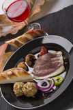Cold starter, with smoked ham, liver bon-bon, and greaves, decor Royalty Free Stock Image