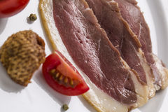Cold starter, with smoked ham, liver bon-bon, and greaves, decor Stock Image