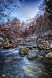 Cold Stones on the Winter River HDR. January on the Big Cottonwood river in the Wasatch mountains of Utah USA Royalty Free Stock Photography