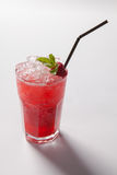 Cold straw red drink with berry and mint leaf. Stock Image