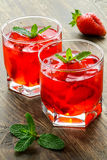 Cold strawberries drinks with strawberry slices Royalty Free Stock Photos