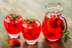 Cold strawberries drinks with strawberry slices Stock Photos