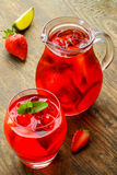 Cold strawberries drinks with strawberry slices Stock Image