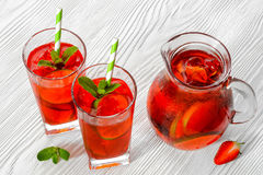Cold strawberries drinks with strawberry slices Royalty Free Stock Images