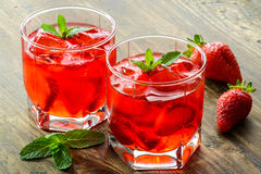 Cold strawberries drinks with strawberry slices Royalty Free Stock Photo