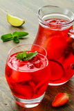 Cold strawberries drinks with strawberry slices Stock Images