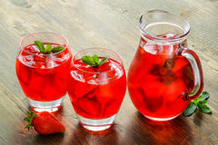 Cold strawberries drinks with strawberry slices Royalty Free Stock Image