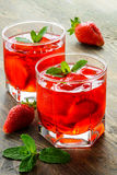 Cold strawberries drinks with strawberry slices stock photography