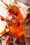 Cold strawberry lemonade with mint close up in a glass jar. vert Stock Photo