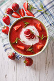 Cold strawberry soup with mint and sour cream in a bowl close-up Royalty Free Stock Photos