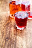 Cold strawberry tea with ice Stock Images