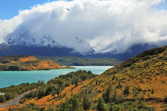 The snowy peaks Los Cuernos. Cold summer in Chile. The National Park Torres del Paine - the emerald waters of the Rio Serrano and snowy peaks Los Cuernos royalty free stock image