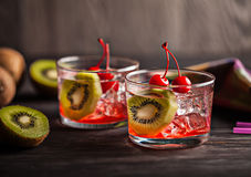 Cold summer cocktail drink with cherry and kiwi Royalty Free Stock Images