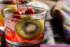 Cold summer cocktail drink with cherry and kiwi Stock Image