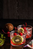 Cold summer cocktail drink with cherry and kiwi Stock Images