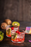 Cold summer cocktail drink with cherry and kiwi Royalty Free Stock Photos