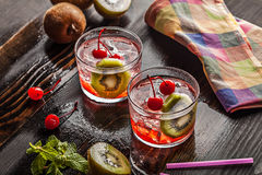 Cold summer cocktail drink with cherry and kiwi Stock Photography