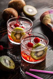 Cold summer cocktail drink with cherry and kiwi Royalty Free Stock Photography