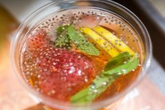 Cold summer detox drink with chia seeds, strawberries, lemon and mint. Close-up stock images