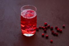 Drink with cranberries with ice, cranberries on a dark background. Fresh cranberry cocktail. Fresh summer cocktail with stock photography